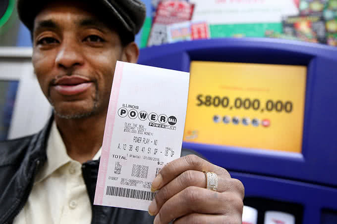 A man with Powerball lottery ticket in his hands