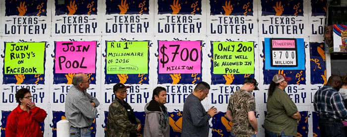 People stand in line to buy lottery tickets